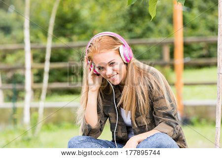 Pretty Girl With Pink Headphones
