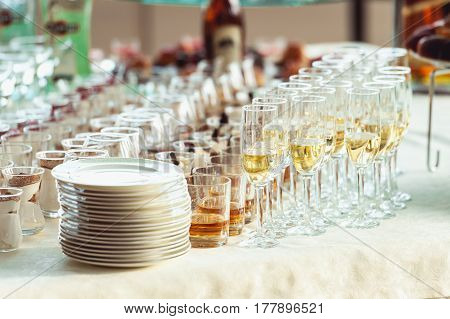 wedding buffet reception wines whisky cognac on a white table