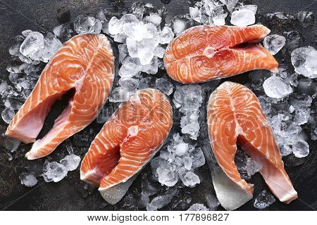 Steaks Of Raw Salmon On Ice.top View With Space For Text.