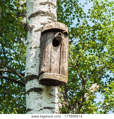 Simple old birdhouse in a rustic style. Concept of the season, guest house, own housing, natural materials,