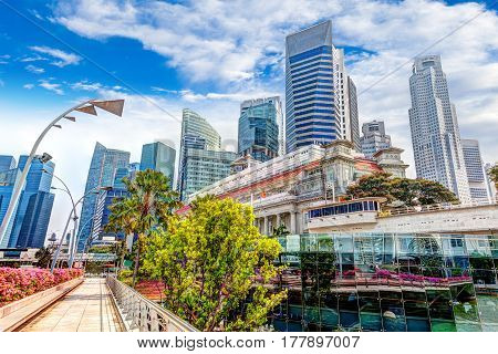 HDR Rendering of Singapore's Skyline at Fullerton taken on Esplanade Bridge over the Singapore River in the downtown financial business district. HDR rendering.