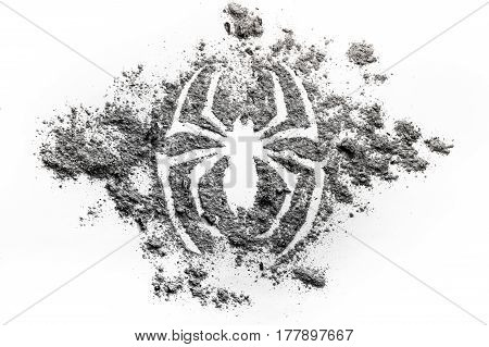 Spider silhouette symbol drawing made in grey ash dirt dust as s superhero phobia animal danger spooky horror concept background