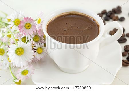 Cup Of Coffee On A Table Decorated With Flowers
