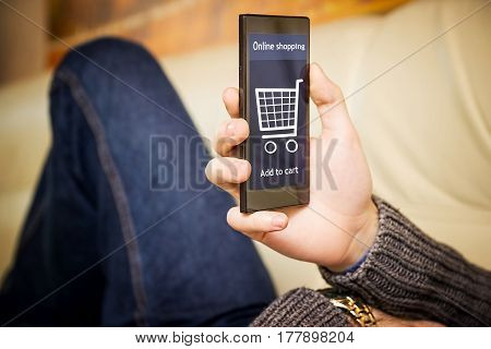 A man is shopping at the online store. Shopping cart icon. Ecommerce