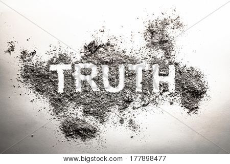 Truth word written in grey ash dust dirt or filth as a cynical concept of lie or post truth in society politics