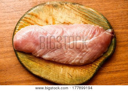 Raw Chicken Fillet On Wooden Board On Table