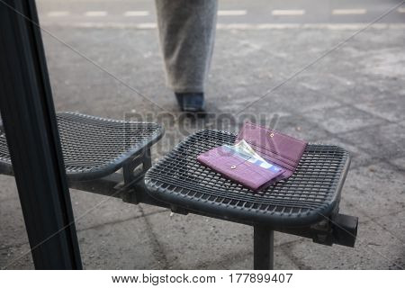 Woman Walking After Losing Her Purse On Bench