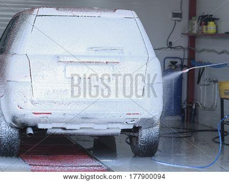 Car in a car washing station