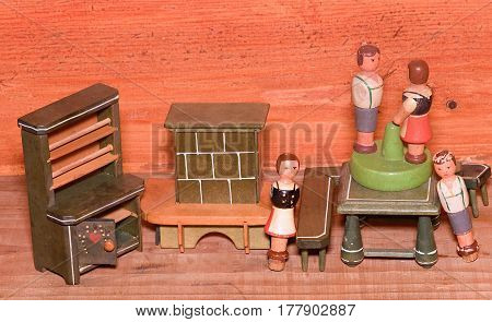 Vintage Toys For Girls. Wooden Retro Toys. Toy Cupboard And Toy Fireplace. Wooden Dummy Of People.