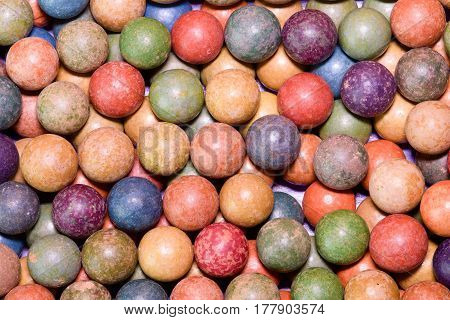Clay marbles (balls). Retro toys. Vintage toys. Shoot (roll/play) marbles. Image can be used as background.