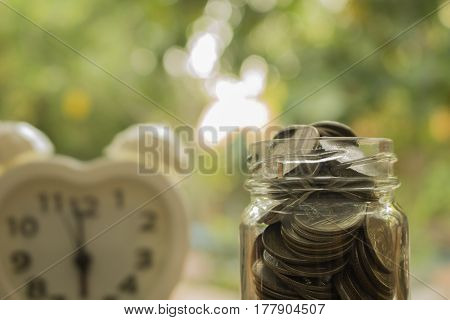 stack of coins full in glass jar,concept for money and save for future.