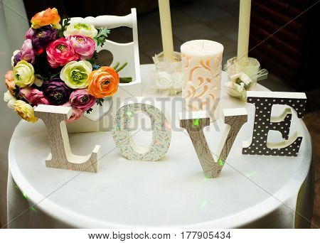 Wedding decoration of a beautiful delicate bouquet lying down on a table.