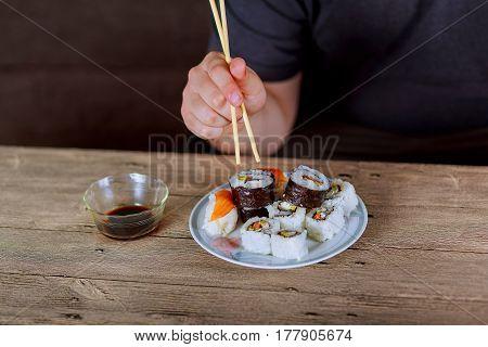 Rolls In Hand,rolls, Sushi,