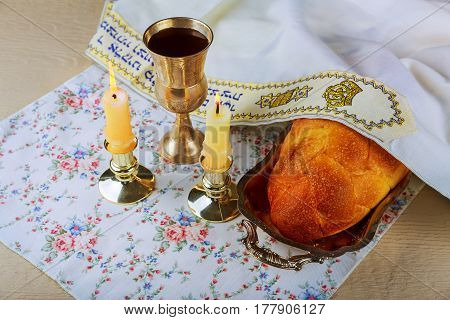 Sabbath Challah Bread, Wine And Candelas Wooden Table.