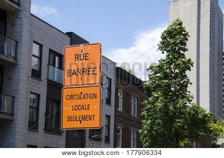 Warning Traffic Sign For Construction Works In The Street In Montreal. The Translation Is