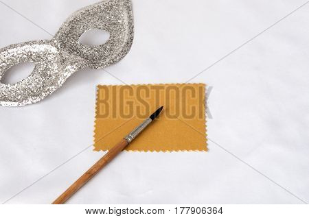 Brush On A Gold Plate And Silver Theatrical Mask