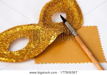 Theatrical Mask And Brush On A Gold Card