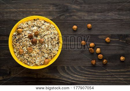 Oatmeal With Nuts Hazelnuts. Oatmeal On A Wooden Table. Oatmeal Top View. Healthy Food