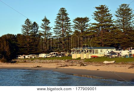 Cabins of the Tuross Beach Holiday Park right at the beach in early morning view. Tuross Head is a seaside village on the south coast of New South Wales Australia.