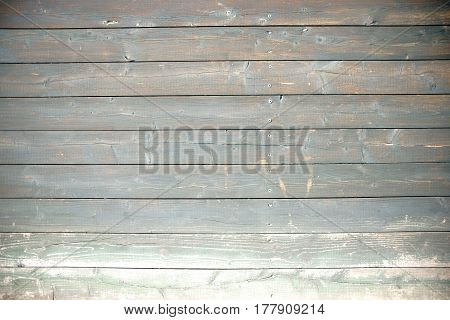 The close-up of a screwed wooden fence.