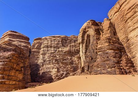 Hiking Sand Dune Barrah Siq Wadi Rum Valley of the Moon Jordan. Inhabited by humans since prehistoric times place where TE Lawrence of Arabia in the early 1900s