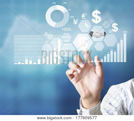 businessman pointing to financial symbols and graphs