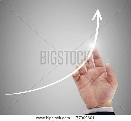 businessman's hand following financial arrow symbol