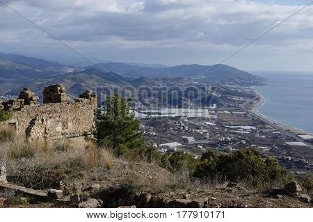 View of Ancient city of Syedra i Alanya province of turkey with mountain landscape on background