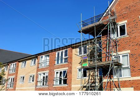 EASTFIELD, SCARBOROUGH, NORTH YORKSHIRE, ENGLAND - 10th of October 2016: Scaffolding on exterior of modern commercial building on 10th October 2016.