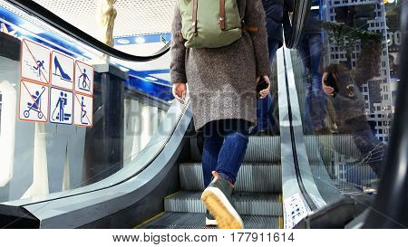 People are moving up on escalators at a shopping center