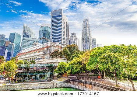 HDR Rendering of Singapore's Skyline at Fullerton taken on Esplanade Bridge over the Singapore River in the downtown financial business district.