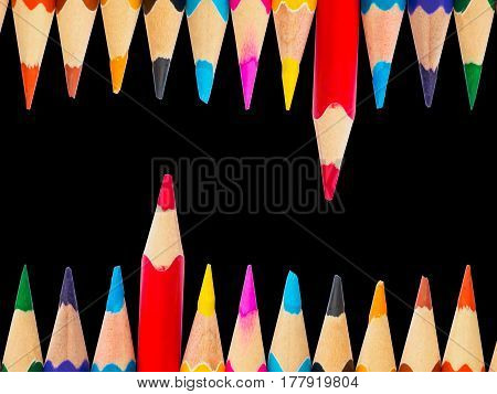 Color pencils isolated on black background. Education material back to school, for background and wallpaper.