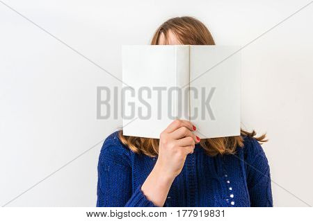 Pretty Woman Reading A Book And Covering Her Face
