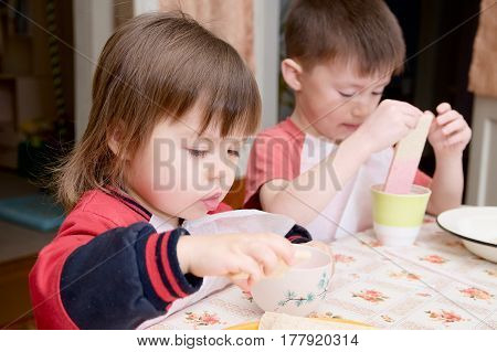 children eating lunch at home healthy food concept kids enjoying bread and yoghurt sibling emotional faces healthy breakfast for brother and sister