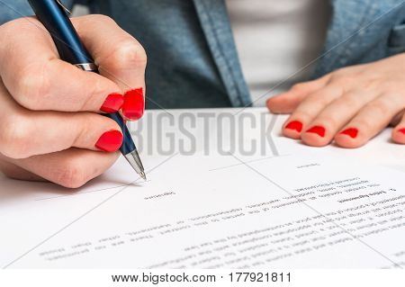 Female Hand Signing Contract To Conclude A Deal
