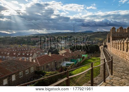 Avila Spain - November 11 2014: Cityscape of Avila from Medieval Walls a cloudy day at sunset. The old city and its extramural churches were declared a World Heritage site by UNESCO