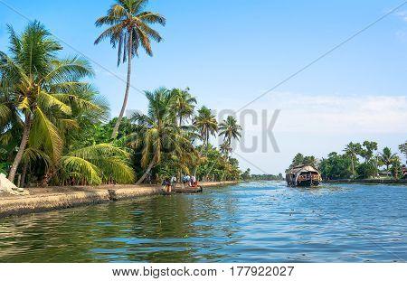Kollam, India 2017: Fishing Boat On The River Near Kollam On Kerala Backwaters, India