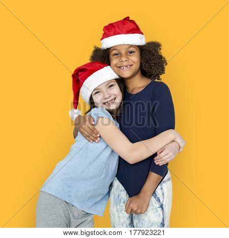Little Girls Friends Hugging Christmas Hat