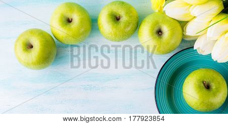 Green Pastel Background With Apples. Healthy Food