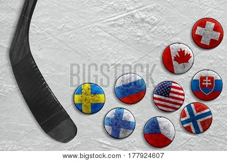 A stick and a hockey puck with images of national flags. Hockey concept