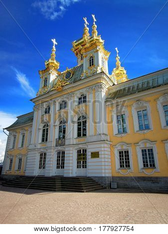 St. Petersburg Russia July 11 2016 View of the palace church of St. Peter and Paul in the summer season a complex of fountains of Peterhof architect Rastrelli editorial