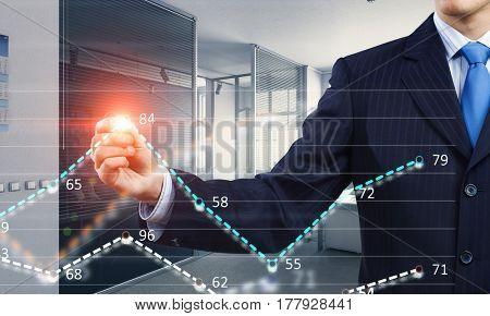 Businessman draw diagrams . Mixed media
