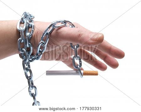 Cigarettes and hand with chain on white background