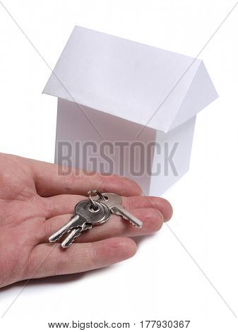 Paper model house and key on white background
