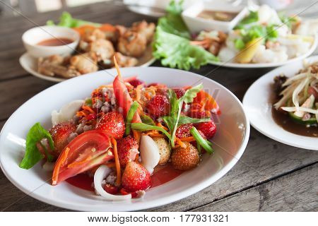 Strawberry spicy salad on white plate Spacial menu in Thailand