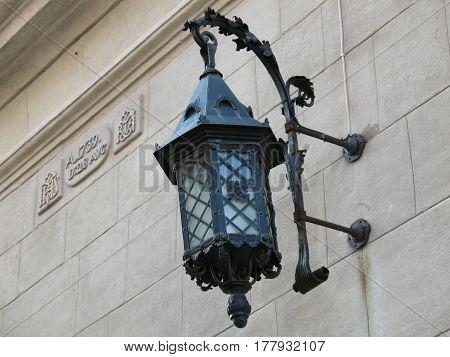 Old wall lamp street lighting. Street retro light on brick wall in city Lviv