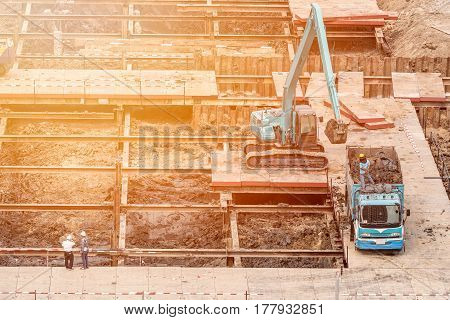 Construction engineer checking construction site with foreman worker for new Infrastructure construction project