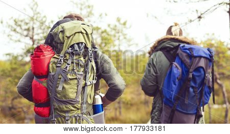 Two handsome bearded men hiking in swamps. Camp, adventure, trip and fishing concept.