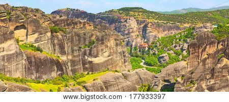 Panoramic banner view of Meteora monasteries on the high cliff rocks, Greece