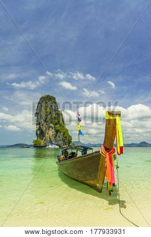 Traditional long-tail boat on the beach in Poda island Thailand